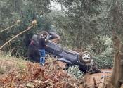 Kanala uçan araç takla attı, içindekiler burnu kanamadan kurtuldu